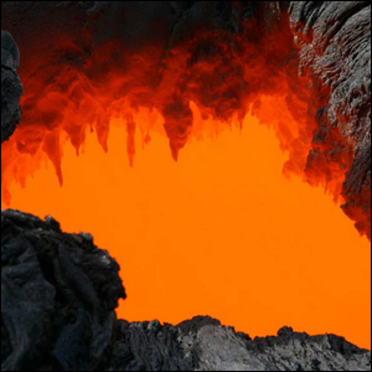 A close-up of a skylight on coastal plain, with lava stalactites forming on the roof of the tube.