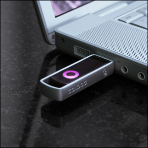 A USB Bluetooth dongle plugged into a laptop computer.