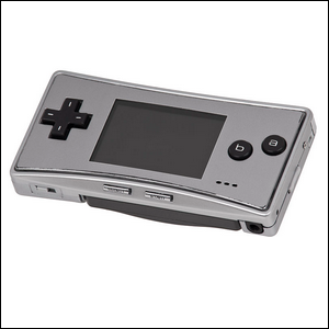 A silver Game Boy Micro displayed against a white background.