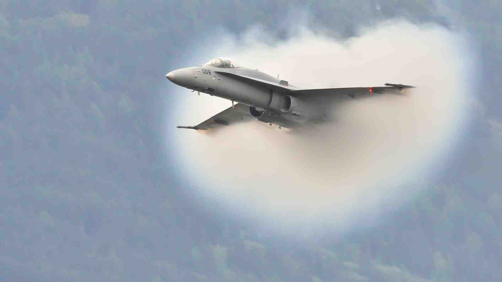 Jet-plane breaks the sound barrier in front of the public during the Breitling Sion airshow on September 17, 2011
