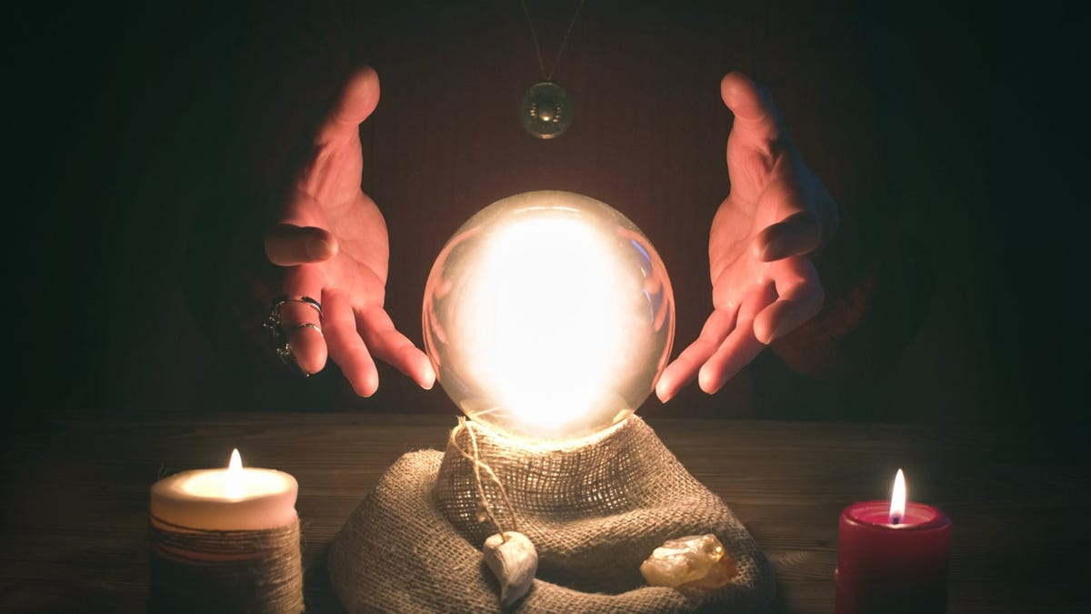 Crystal ball and fortune teller hands