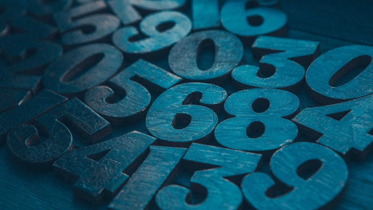 illustration of 3D numerals scattered on table