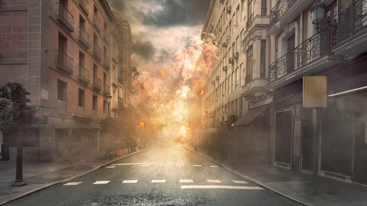 Illustrated view explosion in city streets over dramatic sky background