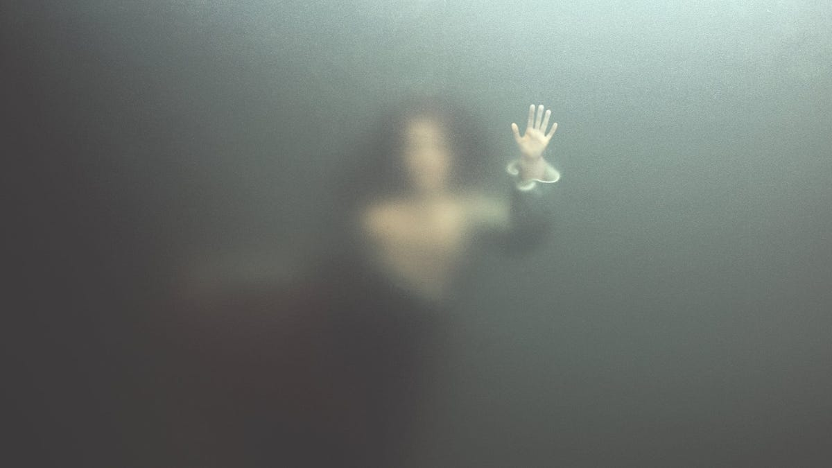 foggy vision of siren swimming underwater, reaching out