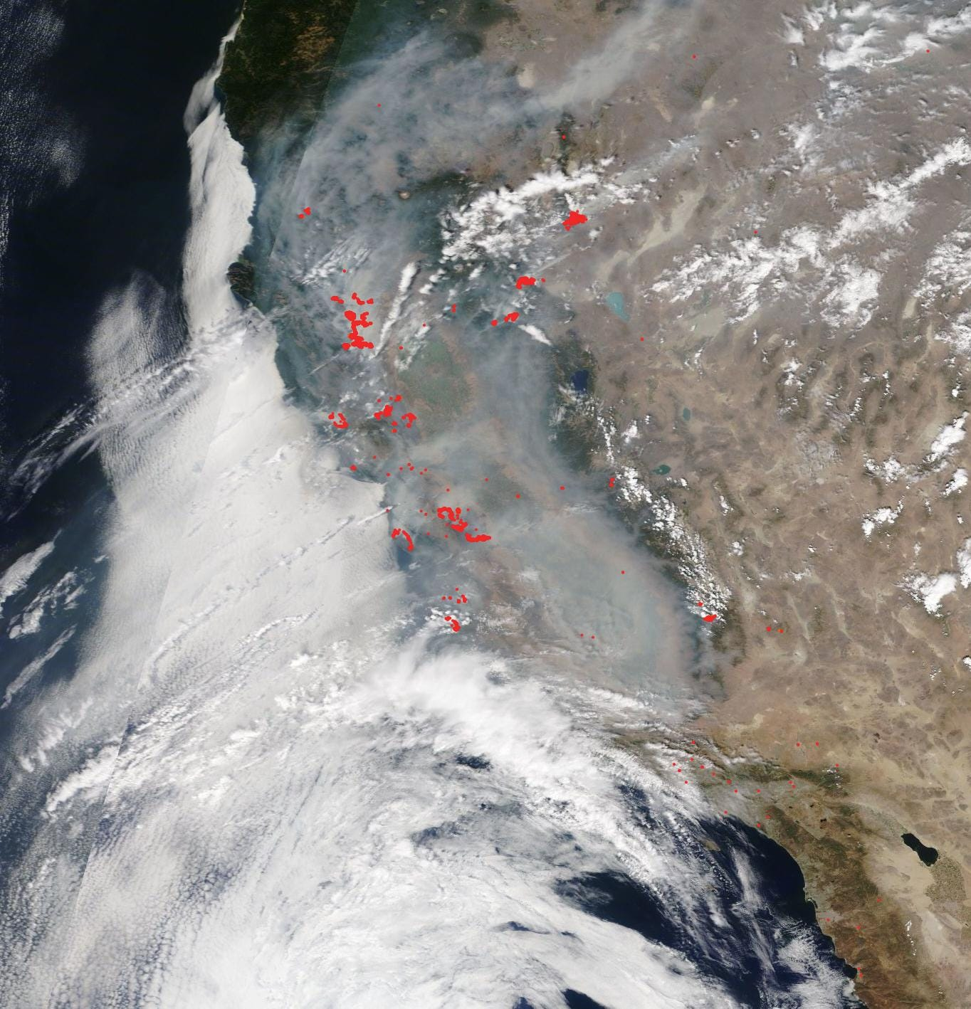 Smoke and fire as seen from space over California