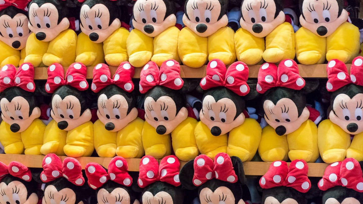 Stacked shelf of Minnie Mouse plush toys in a shop