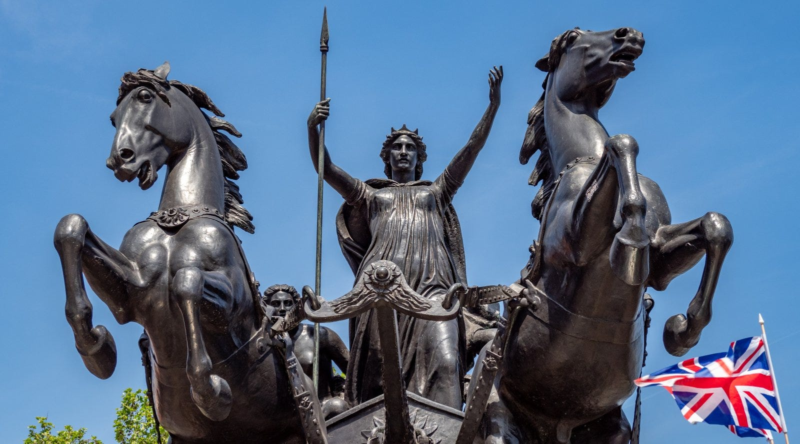 statue of Boudicca on chariot with two horses rearing in foreground