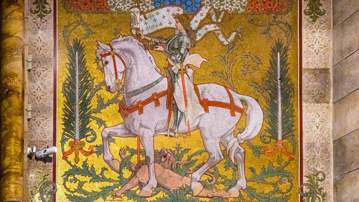 mosaic wall decoration depicting Joan of Arc dressed in armor and atop a white horse