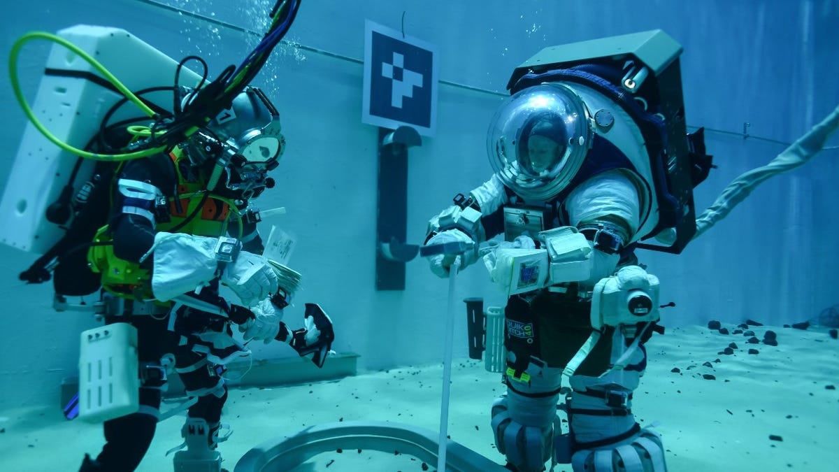 Astronauts working under water