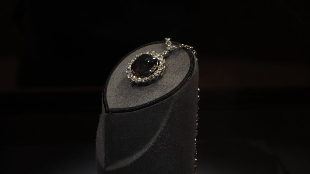 The Hope diamond, displayed on stand covered in gray velvet