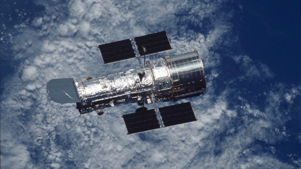 Hubble telescope floating above Earth