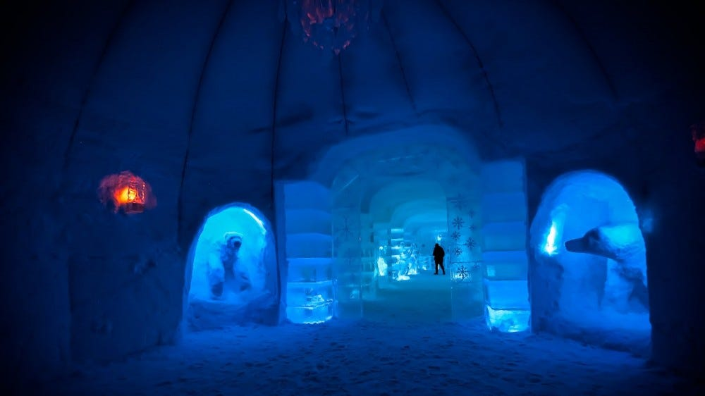 hall of the ice hotel in Norway. snow sculptures of bears and ice doors