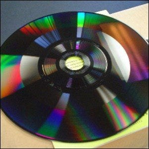 A capacitance electronic disc (CED) with no protective coverings.