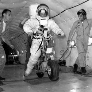 A lunar motorcycle undergoing a low-gravity test aboard a NASA KC-135.