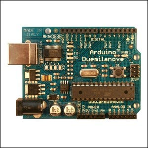 A photo of an Arduino Duemilanove microcontroller board.