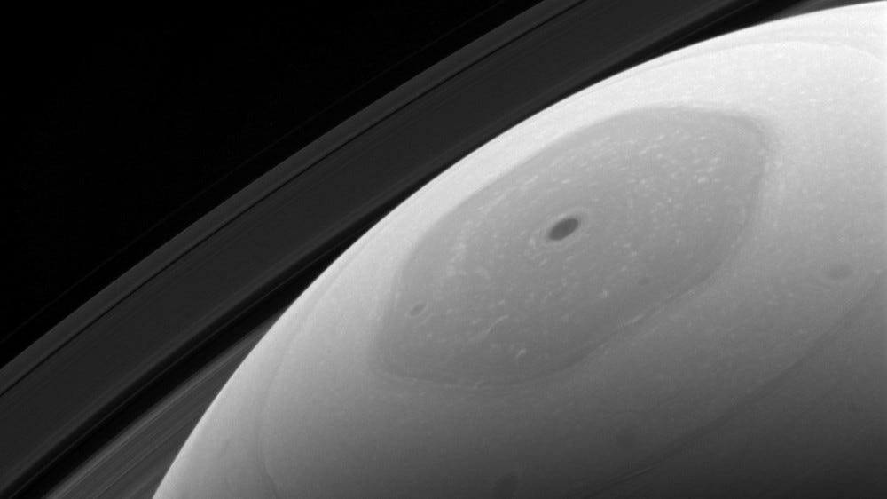 Hexagonal storm in black and white on Saturn