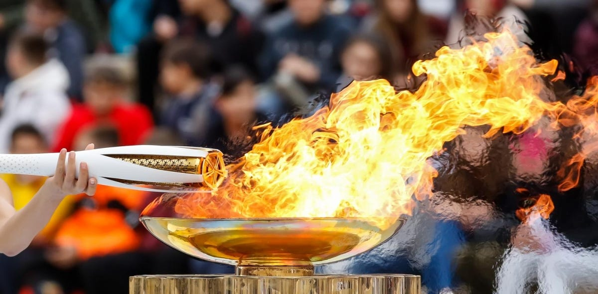 The Olympic flame was handed to organizers of the Pyeongchang (South Korean) Winter Olympics Feb. 9-25, 2018