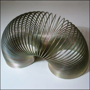 A classic metal Slinky toy.
