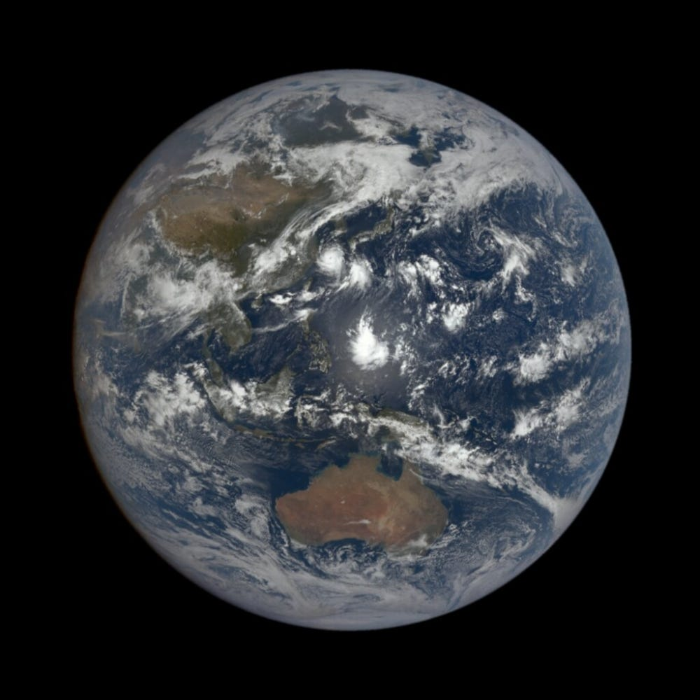 View of Earth with white storm in middle