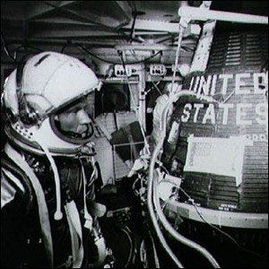 Gordon Cooper standing alongside the Faith-7 spacecraft, the capsule from the Mercury-Atlas 9 mission.
