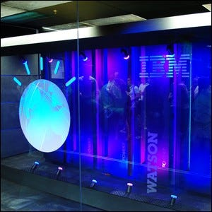 A bank of computers showcasing a section of the Watson supercomputer at an IBM lab.