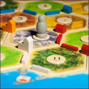 A game of Settlers of Catan in progress.