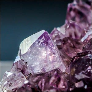 A close-up photo of a beautiful amethyst gemstone.