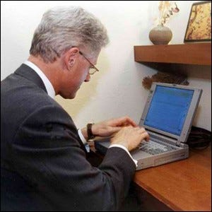 President Bill Clinton sending an email from the White House to John Glenn during his mission in space.