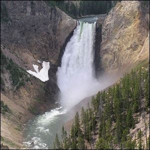 A scenic view of a waterfall in Yellowstone National Park.