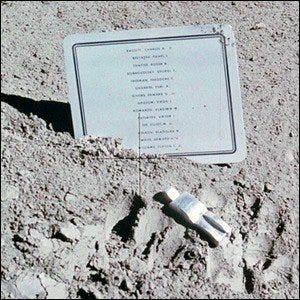 Photograph of the Fallen Astronaut art installation on lunar soil.