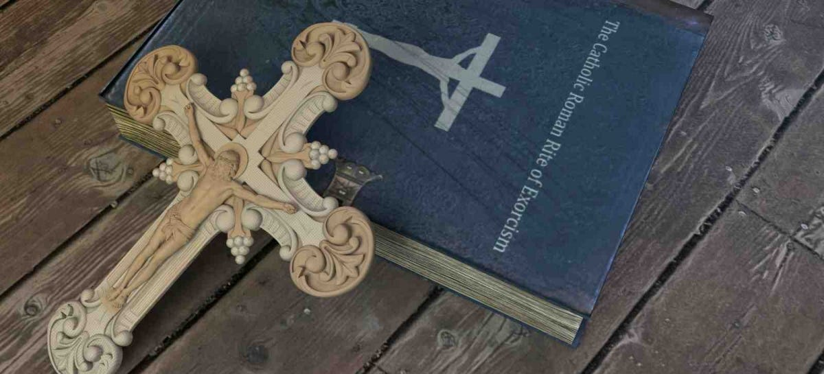exorcism book and cross on wooden floor