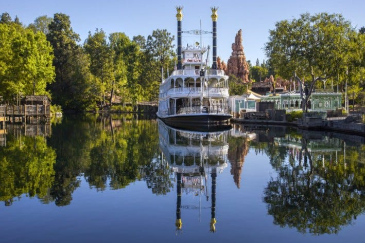 Mark Twain riverboat passing Tom Sawyer Island
