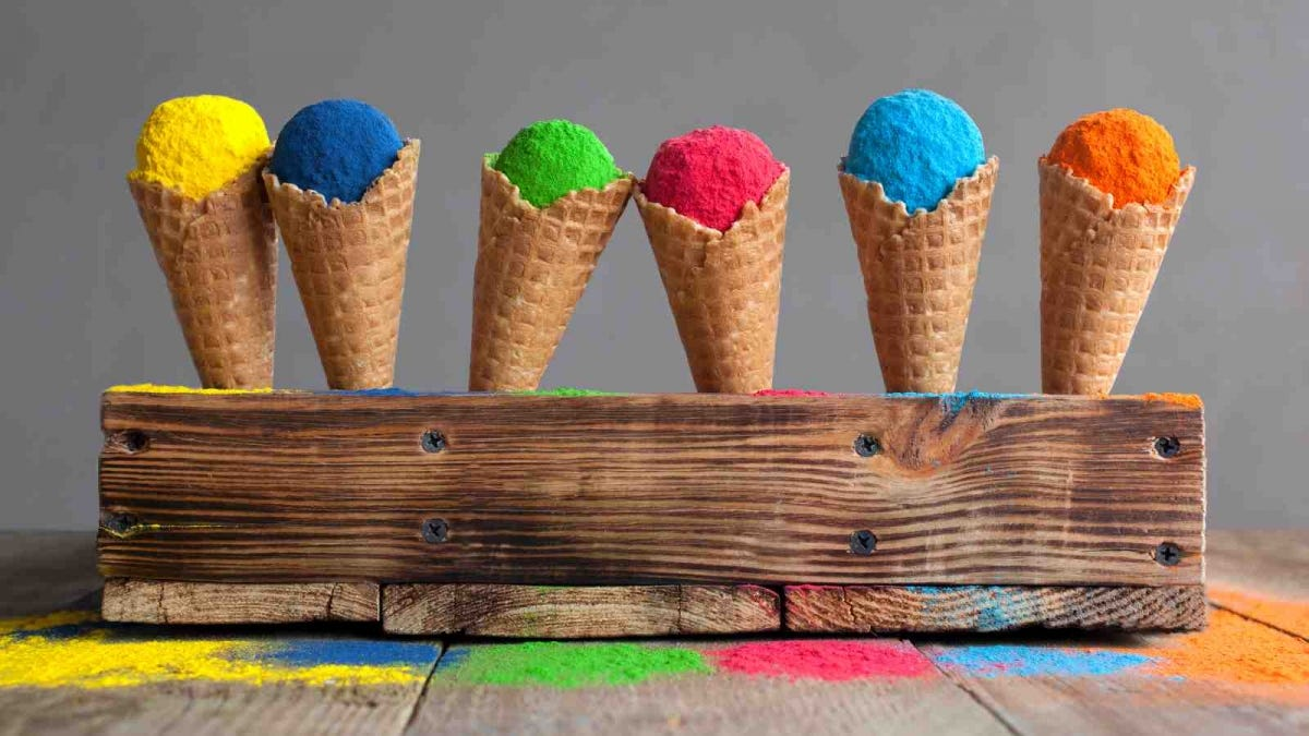 Bright colours in shapes of ice cream scoops in cones for Indian holi festival