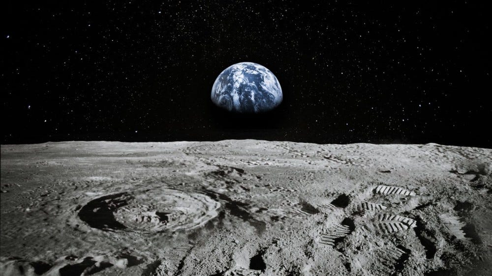 View from Moon with Earth rising on the horizon