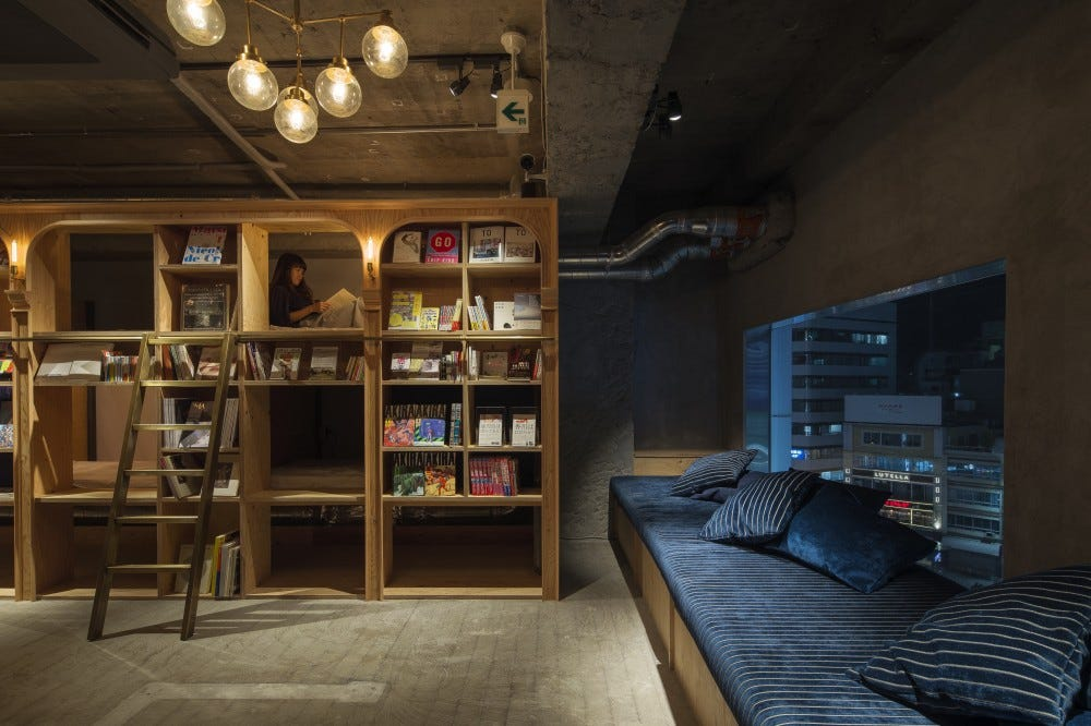 The Book and Bed hostel in Japan, where beds are tucked into cozy cubbyholes behind bookshelves.