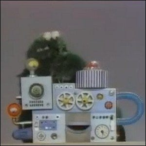 Cookie Monster interacting with the Coffee Break Machine in an IBM training film.