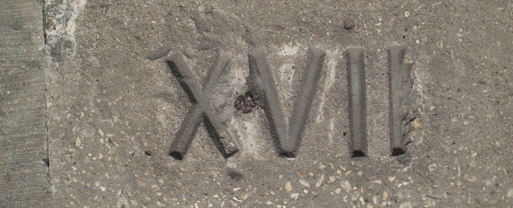 Stone Carved Roman Numeral XVII