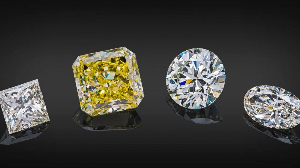 Set of luxury transparent sparkling yellow and colorless diamonds