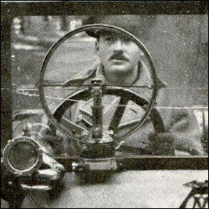 A British test driver demonstrating the rotating glass disk design on the vehicle he is driving.