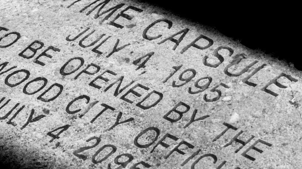 Time capsule stoned cap with letters written on it, fourth of July 1995-2095