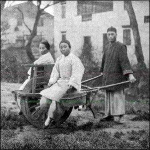 An early 20th century example of a Chinese wheelbarrow.