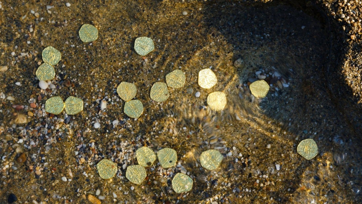 Golden coins on the sea floor